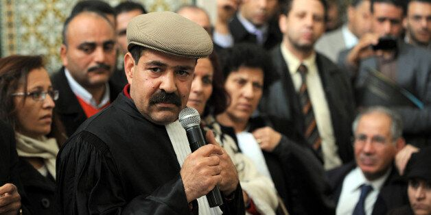 Tunisian lawyer and human rights activist Chokri Belaid speaks as he attends a meeting along with other...