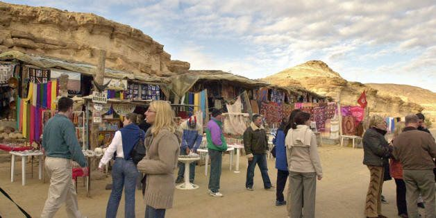 Tozeur, TUNISIA: Tourists visit a market in Tunisian Sahara city of Tozeur, 02 March 2006. Tourism is...