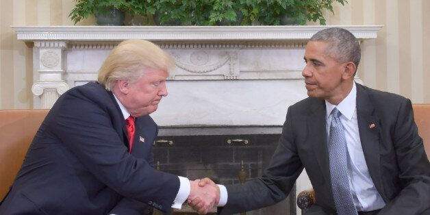 US President Barack Obama shakes hands as he meets with Republican President-elect Donald Trump on transition...