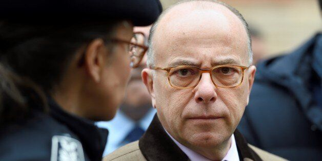 French Interior Minister Bernard Cazeneuve talks with a police chief as part of a visit focused on security...