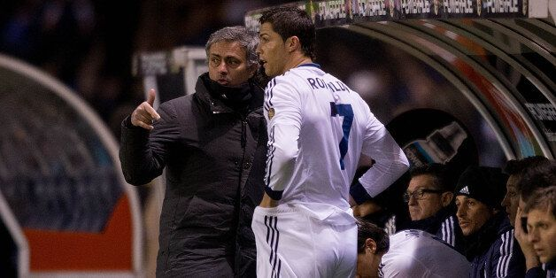 LA CORUNA, SPAIN - FEBRUARY 23: Head coach Jose Mourinho (L) of Real Madrid CF gives instructions to...