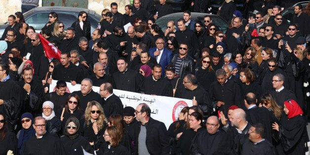 Tunisian lawyers demonstrate against the government's proposed new taxes, near the courthouse in Tunis,...