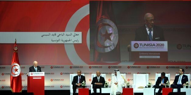 Tunisian President Beji Caid Essebsi (L) gives a speech during the opening ceremony of the 'Tunisia 2020'...