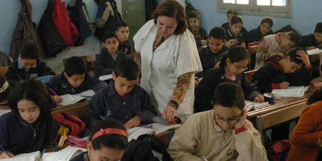 TO GO WITH AFP STORY IN FRENCH 'Education-Maghreb-UN' A Tunisian teacher explains a lesson to her students...