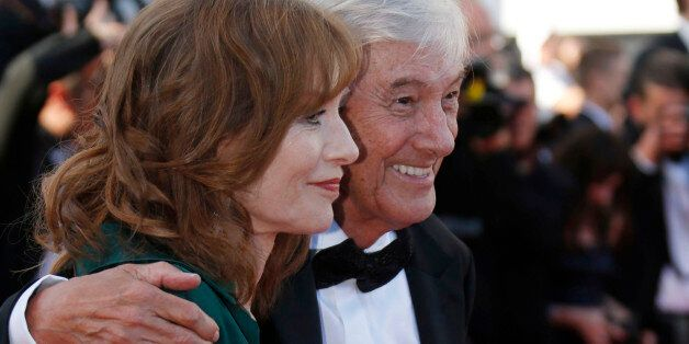 Director Paul Verhoeven (R) and cast member Isabelle Huppert pose on the red carpet as they arrive for...