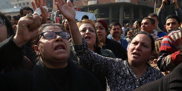 CAIRO, EGYPT - DECEMBER 12: People react during the funeral ceremony for the victims of the explosion...