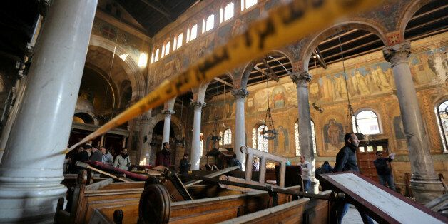 Damage from the explosion inside Cairo's Coptic Orthodox Cathedral is seen inside the cathedral in Cairo,...