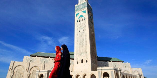 Moroccan women walk past the Hassan II mosque in Casablanca February 24, 2011. The minaret of the mosque...