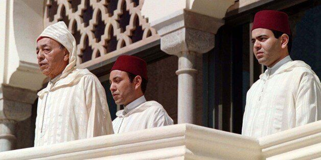 Moroccan King Hassan II (L) listens to the national anthem with his sons Crown Prince Sidi Mohammed and...
