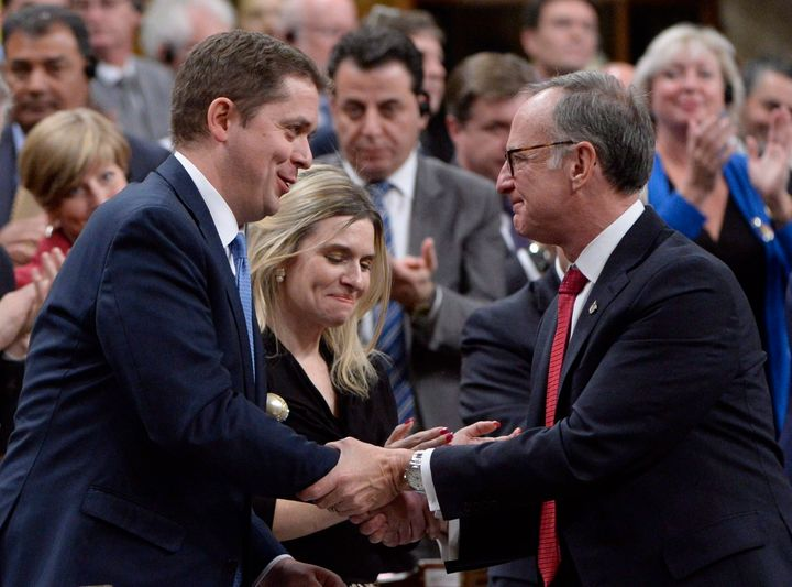 Conservative Leader Andrew Scheer shakes hands with Liberal MP Rob Oliphant (right) after Scheer's speech in the House of Commons on Nov. 28, 2017 following a formal apology to individuals harmed by federal legislation, policies, and practices that led to the oppression of and discrimination against LGBTQ2 people in Canada.
