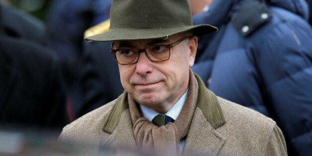 French Interior Minister Bernard Cazeneuve leaves after a visit at the traditional Christkindelsmaerik...
