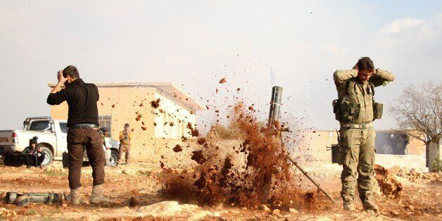 ALEPPO, SYRIA - DECEMBER 11: Members of Free Syrian Army attack Daesh terrorists' positions with heavy...