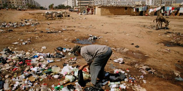 A man searches for food amongst garbage at Duar Skuila slum in Casablanca September 1, 2007. Hopelessness...
