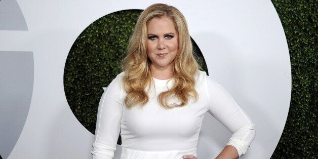 Comedian Amy Schumer poses during the GQ Men of the Year party in West Hollywood, California December...