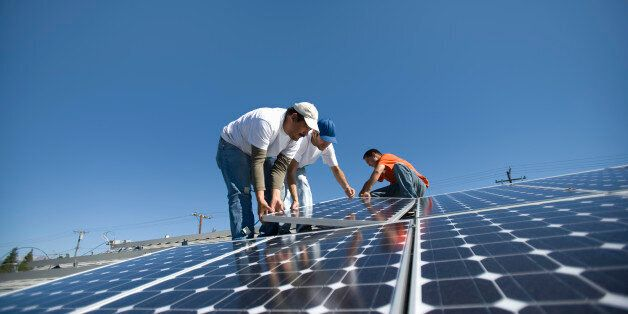 A group of men working on solar