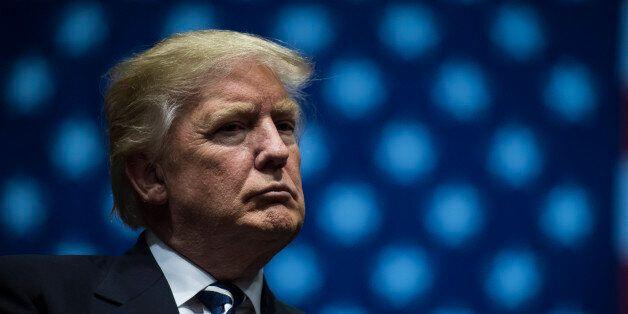 GRAND RAPIDS, MI - DECEMBER 9: President-Elect Donald J. Trump listens at a 'USA Thank You Tour 2016'...