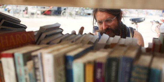 Dario Clocchiatti looks for a book at one of the temporary libraries on