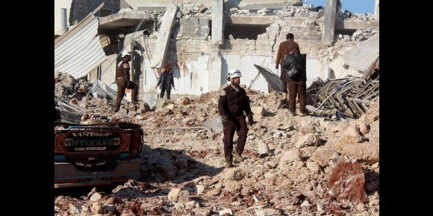 ALEPPO, SYRIA - DECEMBER 6: Civil defense team members carry out search and rescue works after the war...
