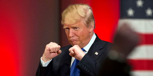 FILE - In this Jan. 28, 2016, file photo, Republican presidential candidate Donald Trump poses with a...