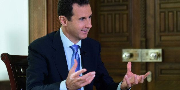 Syria's President Bashar al-Assad speaks during an interview with a Portuguese television channel in...