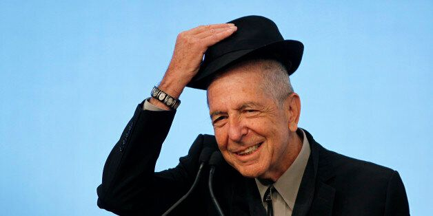 Musician Leonard Cohen tips his hat to the audience as he accepts the 2012 Awards for Song Lyrics of...