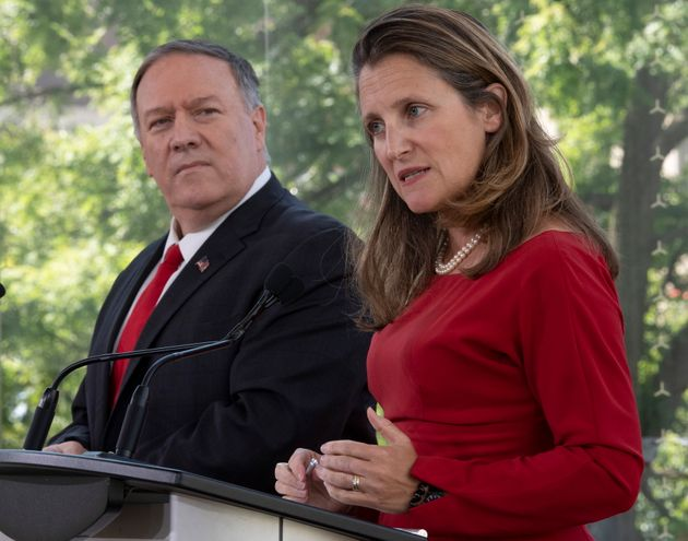 US Secretary of State Mike Pompeo looks on as Foreign Affairs Minister Chrystia Freeland responds to...