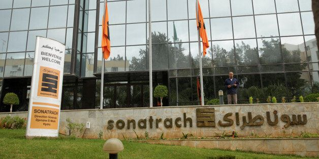 An employee stands near the headquarter of the state energy company Sonatrach in Algiers, Algeria june...