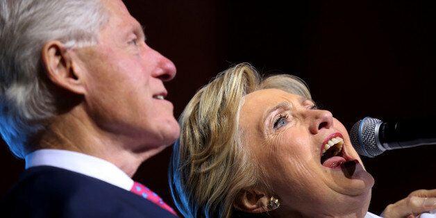 Democratic U.S. presidential candidate Hillary Clinton, acompanied by former president Bill Clinton,...