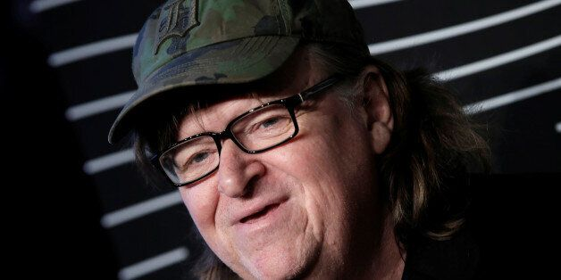 Filmmaker Michael Moore poses as he arrives for the 20th Annual Webby Awards in Manhattan, New York,...