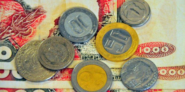 Algerian 1000 dinar bank notes and coins - currency of Algeria, DZD - photo by