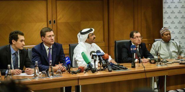 Russian Energy Minister Alexander Novak (2L), Mohammed bin Saleh al-Sada (C), President of the Organization...