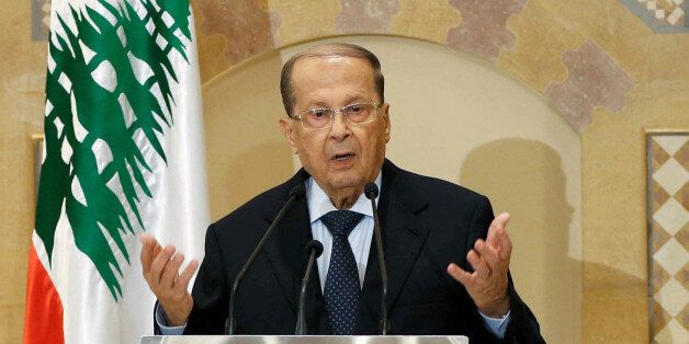 Christian politician and FPM founder Michel Aoun talks during a news conference in Beirut, Lebanon October...