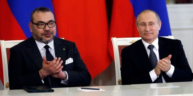 Russian President Vladimir Putin, right, and Morocco's King Mohammed VI attend a signing ceremony after...