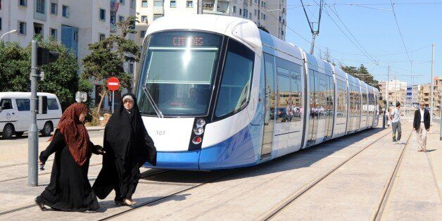 Women cross in front of a new tramcar on May 8, 2011 in Algiers. After a two-year delay, the new tramway...