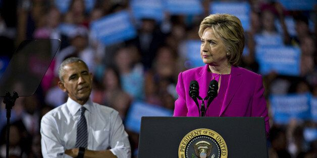 Hillary Clinton, presumptive 2016 Democratic presidential nominee, pauses while speaking as U.S. President...
