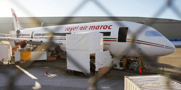 A 787 Dreamliner jet painted in Royal Air Maroc livery, sits idle on the tarmac parking at Paine Field...