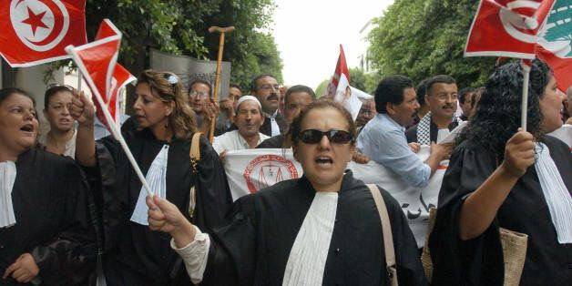 Tunis, TUNISIA: Tunisian Lawyers shout during a protest against the Israeli offensive in Lebanon 09 August...