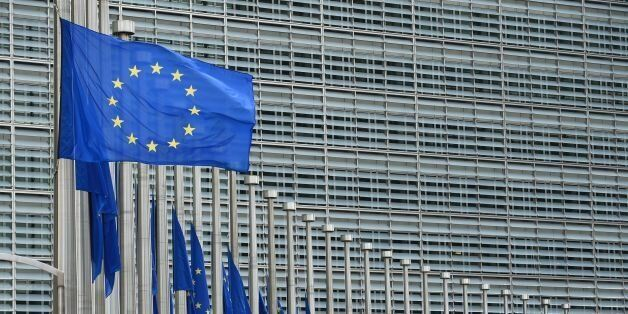 This photo taken on July 15, 2016 shows European Union flags flying at half-mast in front of the European...