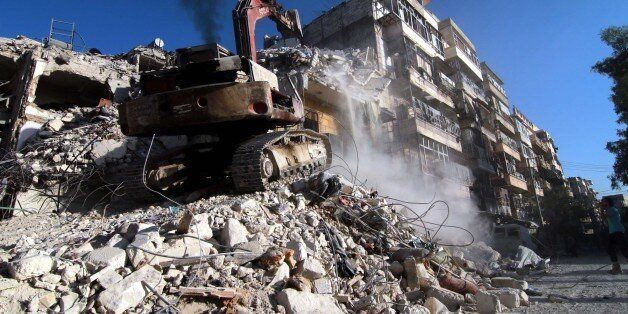 ALEPPO, SYRIA - OCTOBER 17: Heavy construction equipment clears the collapsed buildings after War Crafts...