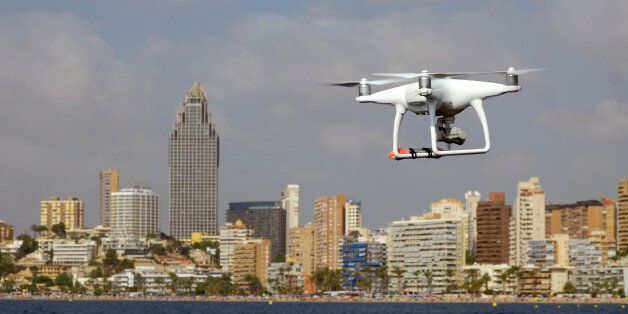 A drone, equipped with a camera used by police for surveillance tasks, flies in front of Poniente beach...