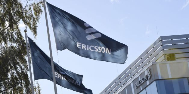 Flags with the logo of telecoms equipment maker Ericsson flutter outside the company's headquarters in...