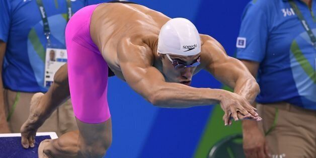 Algeria's Oussama Sahnoune competes in a Men's 100m Freestyle heat during the swimming event at the Rio...