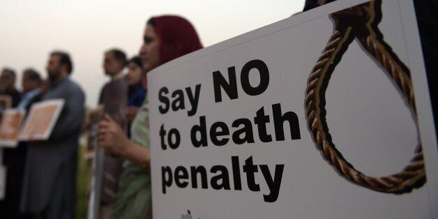 Activists from the Human Rights Commission of Pakistan (HRCP) carry placards during a demonstration to...