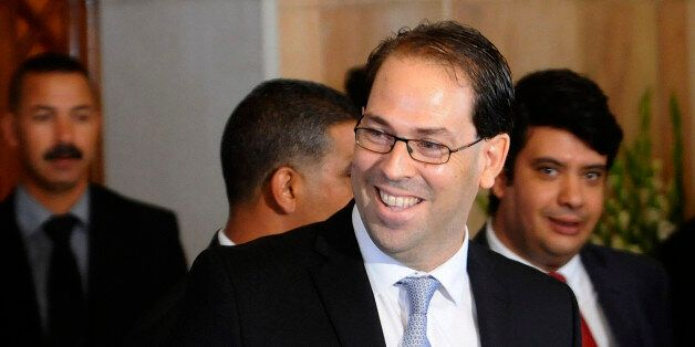 Tunisia's new Prime Minister Youssef Chahed smiles before a press conference at the presidential palace...