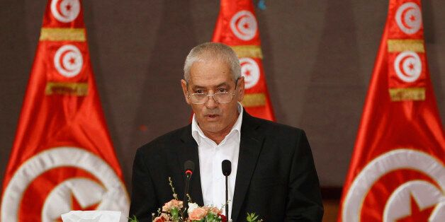 Secretary General of the Tunisian General Labour Union (UGTT) Houcine Abassi speaks during the National...