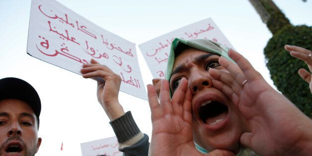 A Moroccan shouts as thousands of Moroccans protest against the death of Mouhcine Fikri last Friday,...