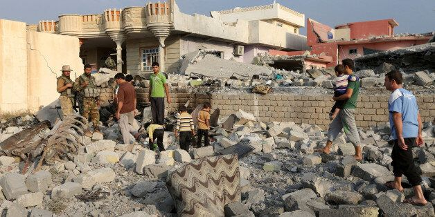 Smoke raises after Kurdish Peshmerga fighters disabled IEDÕs and recaptured from Islamic state militants...