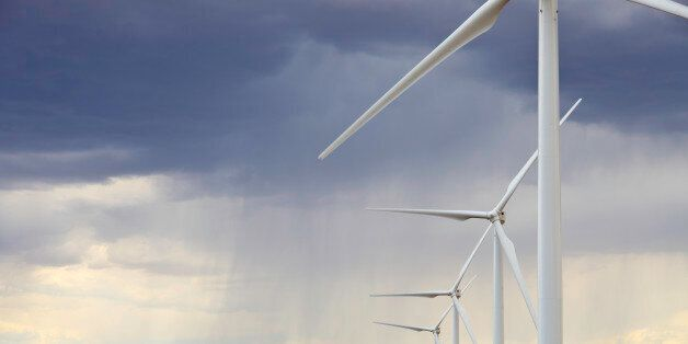 Summer thunderstorms pass through huge wind farm in central Utah. This facility generates over 200 Megawatts...