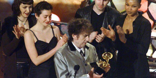 Bob Dylan accepts his Grammy Awards after winning for album of the year at the Grammy Awards February...