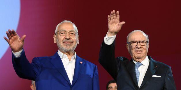 Tunisian president Beji Caid Essebsi (R) and Islamist Ennahdha Party leader Rached Ghannouchi (L) wave...
